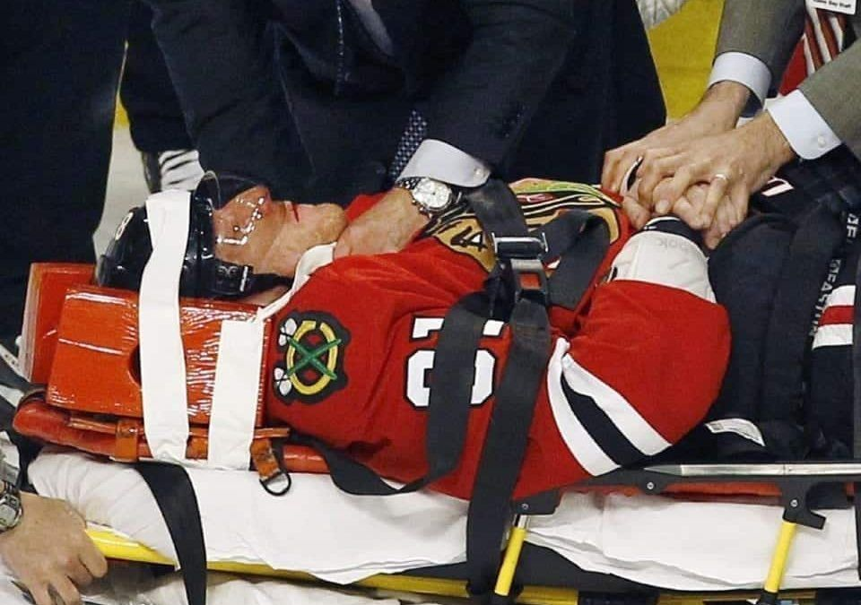 Injured Hockey Player Stretchered