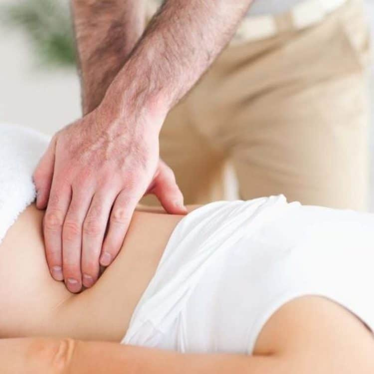 Patient receiving manual therapy treatment at Pillars of Wellness